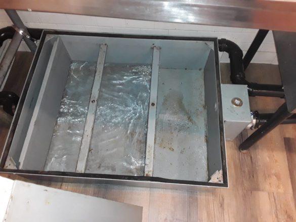 Repairing clean restaurant grease trap